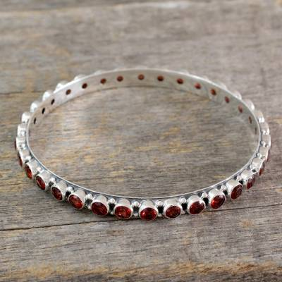 Garnet bangle bracelet, 'Love's Energy' - 15-carat Garnet Fair Trade Silver Bangle Bracelet from India