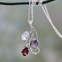 Amethyst, blue topaz and garnet pendant necklace,