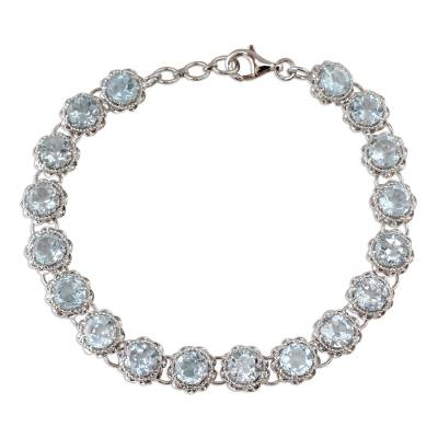 Tennis Bracelet with Blue Topaz Set in Sterling Silver