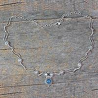 Blue topaz and chalcedony pendant necklace, 'Celestial Trail' - Blue Topaz and Chalcedony Silver Pendant Necklace