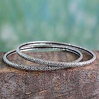 Sterling silver bangle bracelets, 'Circle in Motion' (pair) - Artisan Crafted Textured Sterling Silver Bangles (Pair)