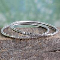 Sterling silver bangle bracelets, 'Scallop Fantasy' (pair) - Indian Artisan Crafted Sterling Silver Bangle Bracelet Pair