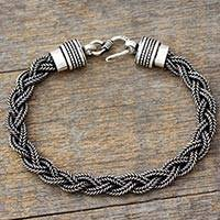 Men's sterling silver braided bracelet, 'Weaves of Life' - Braided Triple Chain Men's Bracelet in Sterling Silver