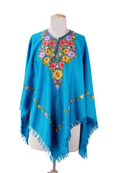 Wool poncho, 'Colorful Affair' - Artisan Crafted 100% Wool Blue Poncho with Floral Embroidery