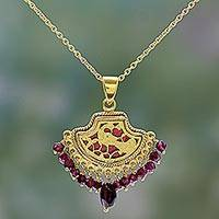 Gold plated garnet pendant necklace, 'Radiant Peacock' (India)