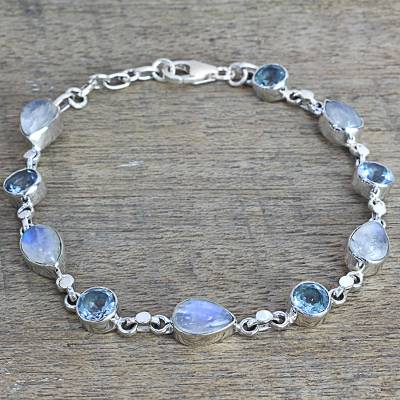 Rainbow moonstone and blue topaz link bracelet, 'Misty Sky' - Blue Topaz and Rainbow Moonstone Gemstone Station Bracelet