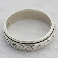 Sterling silver spinner ring, 'Spinning Leaves' - Sterling Silver Spinner Ring with Leaf Motifs from India