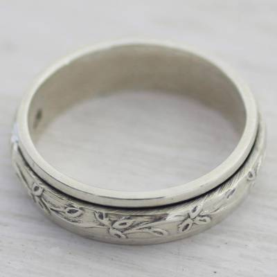 Sterling silver meditation spinner ring, 'Spinning Leaves' - Sterling Silver Spinner Ring with Leaf Motifs from India