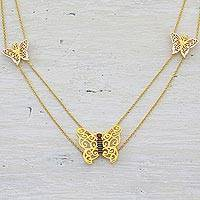 Gold plated garnet long pendant necklace, 'Charming Butterflies' - Gold Plated Garnet Butterfly Pendant Necklace from India