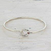 Sterling silver and garnet bangle bracelet, 'A Little Accent' - Hand Crafted Sterling Silver Bangle Bracelet Garnet Accent
