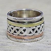 Sterling silver spinner ring, 'Spinning Braid' - Sterling Silver Copper and Brass Spinner Ring from India
