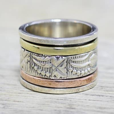 Sterling silver meditation spinner ring, 'Entrancing Nature' - Sterling Silver Copper and Brass Indian Leaf Spinner Ring