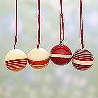 Wood ornaments, 'Cheery Holidays' (set of 4) - Set of Four Round Red Wood Ornaments by Indian Artisans