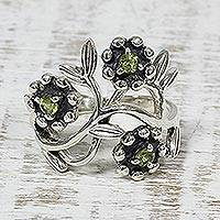Peridot cocktail ring, 'Floral Glimmer' - Floral Peridot and Sterling Silver Cocktail Ring from India