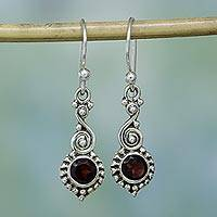 Garnet dangle earrings, 'Sunset Swirls' - Garnet and Sterling Silver Spiral Earrings from India