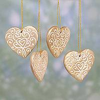 Ceramic ornaments, 'Christmas Hearts' (set of 4) - Four Handcrafted Ceramic Heart Ornaments in Gold