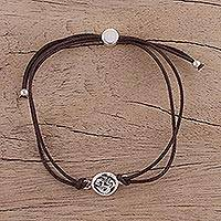 Sterling silver pendant bracelet, 'Om Saga in Brown' - Indian Sterling Silver and Cotton Cord Om Pendant Bracelet
