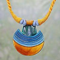 Ceramic pendant necklace, 'Kutch Sunrise' - Ceramic and Cotton Pendant Necklace in Yellow from India