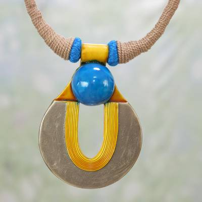 Ceramic pendant necklace, 'Union of Time' - Handcrafted Ceramic and Cotton Pendant Necklace from India