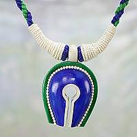 Ceramic pendant necklace, 'Locked Away' - Handcrafted Ceramic and Cotton Pendant Necklace from India