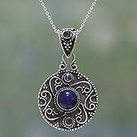 Lapis lazuli and blue topaz pendant necklace, 'Swirling Harmony' - Lapis Lazuli and Blue Topaz Pendant Necklace from India