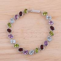 Rhodium plated multi-gemstone link bracelet, 'Shimmering Harmony' - Oval Faceted Multi-Gemstone Sterling Silver Link Bracelet