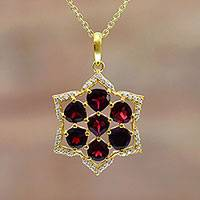 Gold accent garnet pendant necklace, 'Floral Fire' - Gold Plated Floral Garnet Pendant Necklace from India
