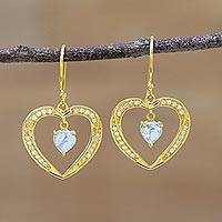 Gold plated blue topaz dangle earrings, 'Sparkling Hearts' - Gold plated Blue Topaz Heart Dangle Earrings from India