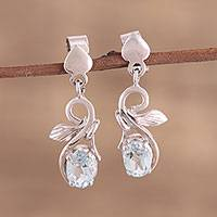 Rhodium plated blue topaz dangle earrings, 'Blue Swirl' - Rhodium Plated Blue Topaz Dangle Earrings from India