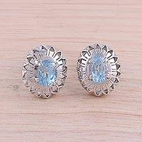 Rhodium plated blue topaz button earrings, 'Radiant Rays' - Rhodium Plated Blue Topaz Button Earrings from India
