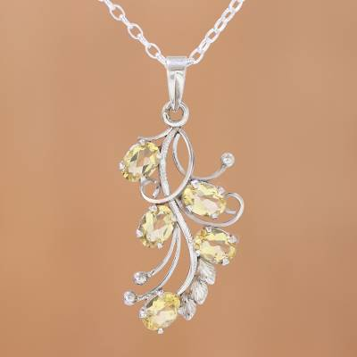 Citrine pendant necklace, 'Shimmering Blossoms' - Handcrafted Rhodium Plated Citrine Pendant Necklace