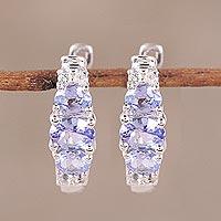 Rhodium plated tanzanite and topaz hoop earrings,