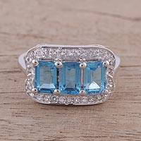 Rhodium plated blue topaz cocktail ring, 'Dazzling Blue Trio' - Rhodium Plated Blue Topaz and CZ Ring from India