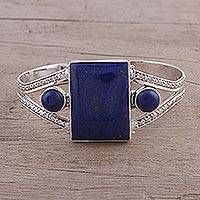 Lapis lazuli cuff bracelet, 'Crisscross Magic' - Lapis Lazuli and Sterling Silver Cuff Bracelet from India