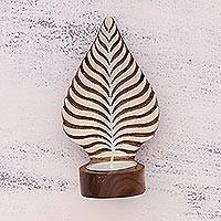Wood tealight holder sconce, 'Betel Leaf Glow' - Leaf-Shaped Rohida Wood Tealight Sconce from India