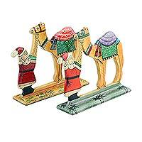 Wood decorative accents, 'Desert Santa' (pair) - Hand Carved Wood Decor Accents with Santa and Camel (Pair)