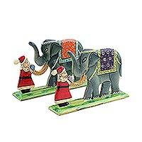 Wood decorative accents, 'Jungle Santa' (pair) - Hand Painted Christmas Decor with Santa and Elephants (Pair)