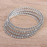 Sterling silver bangle bracelets, 'Dots and Waves' (set of 4) - Set of Four Sterling Silver Bangle Bracelets from India