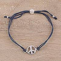 Sterling silver pendant bracelet, 'Peaceful Gleam in Navy' - Navy Blue Cord Bracelet with a Sterling Silver Peace Sign