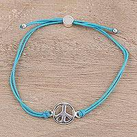 Sterling silver pendant bracelet, 'Peaceful Gleam in Aqua' - Sterling Silver Peace Sign and Aqua Cord Bracelet