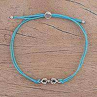 Sterling silver pendant bracelet, 'Vajra in Turquoise' - Adjustable Cord Bracelet with Sterling Silver Vajra Pendant