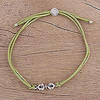 Sterling silver pendant bracelet, 'Vajra in Pistachio' - Light Green Cord Bracelet with Sterling Vajra Pendant