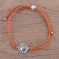 Sterling silver pendant bracelet, 'Orange Surya Blaze' - Orange Cord Bracelet with a Sterling Silver Sun Face