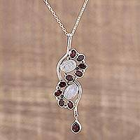 Garnet and rainbow moonstone pendant necklace, 'Sparkling Spiral' - Garnet and Rainbow Moonstone Pendant Necklace from India