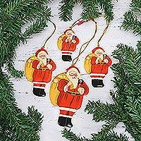 Papier mache ornaments, 'Bringing Gifts' (set of 4) - Papier Mache Santa Ornaments (Set of 4) from India
