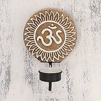 Wood tealight candle sconce, 'Om Illumination' - Handcarved Om Motif Wood Tealight Candle Sconce from India