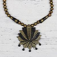 Ceramic pendant necklace, 'Flowering Lotus' - Hand-Painted Black and Gold Lotus Flower Pendant Necklace