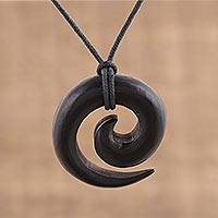 Ebony wood pendant necklace, 'Captivating' - Hand Carved Ebony Wood Spiral Motif Pendant Necklace
