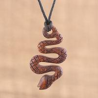 Ebony wood pendant necklace, 'Serpent's Twist' - Hand Carved Ebony Wood Snake Pendant Necklace