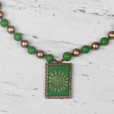 Ceramic pendant necklace, 'Sunny Pastures' - Gold and Green Ceramic Framed Sun Beaded Pendant Necklace